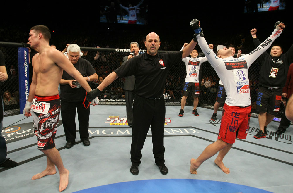 Dong Hyun Kim celebrates his win over Nate Diaz at UFC 125