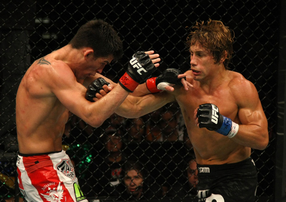 Urijah Faber punches Dominick Cruz during their bout at UFC 132 on 7/2/11 in Las Vegas, NV (Photo by Donald Miralle/Zuffa LLC)