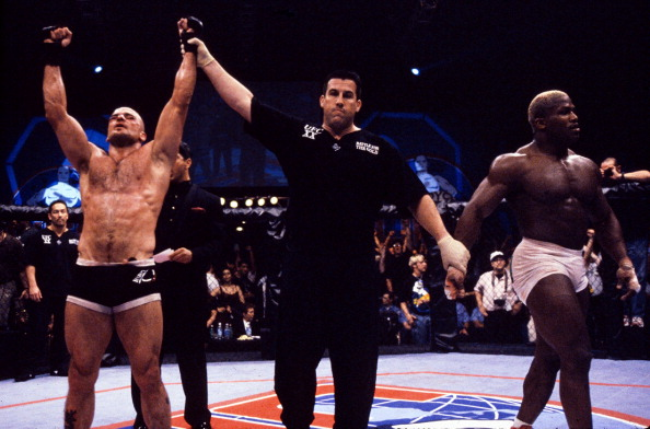 Bas Rutten (L) wins a controversial decision over Kevin Randleman (R) to capture the UFC Heavyweight Championship at the Boutwell Auditorium on May 7, 1999 in Birmingham, AL. (Photo by Susumu Nagao/Zuffa LLC)