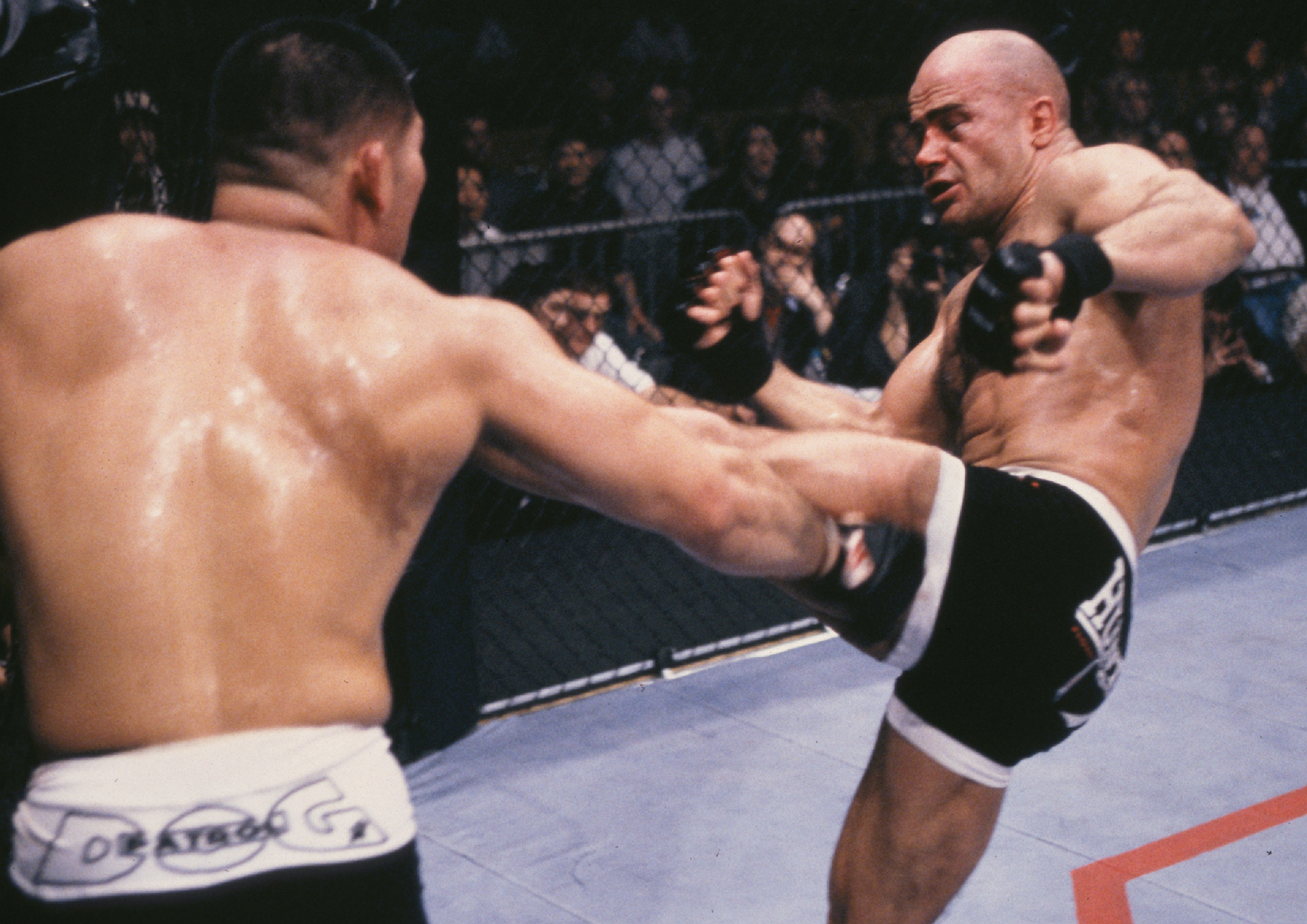 Bas Rutten (R) kicks Tsuyoshi Kosaka during their bout at UFC 18 on January 8, 1999 in Kenner, Louisiana. (Photo by Josh Hedges/Zuffa LLC)