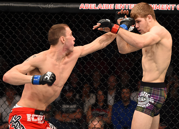 (L-R) James Vick punches Jake Matthews in their bout during the UFC Fight Night event on May 10, 2015 in Australia. (Photo by Josh Hedges/Zuffa LLC)