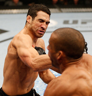 (L-R) Danny Castillo punches Edson Barboza in their lightweight bout during the UFC on FOX event at Sleep Train Arena on December 14, 2013 in Sacramento, CA. (Photo by Josh Hedges/Zuffa LLC)