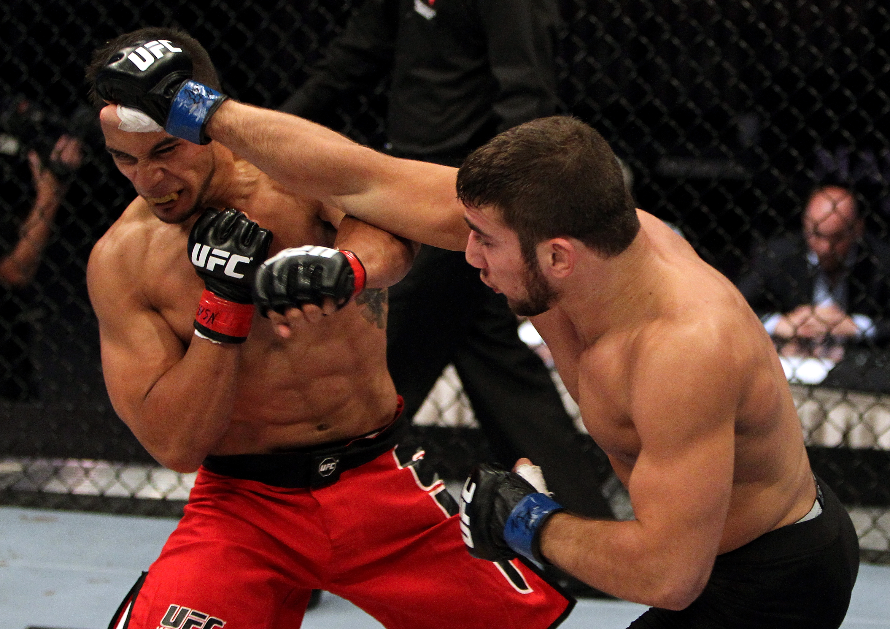 (R-L) Jimmie Rivera punches Dennis Bermudez during their Featherweight bout at the TUF 14 Elimination fights inside the Mandalay Bay Events Center on June 7, 2011 in Las Vegas, Nevada. (Photo by Josh Hedges/Zuffa LLC)