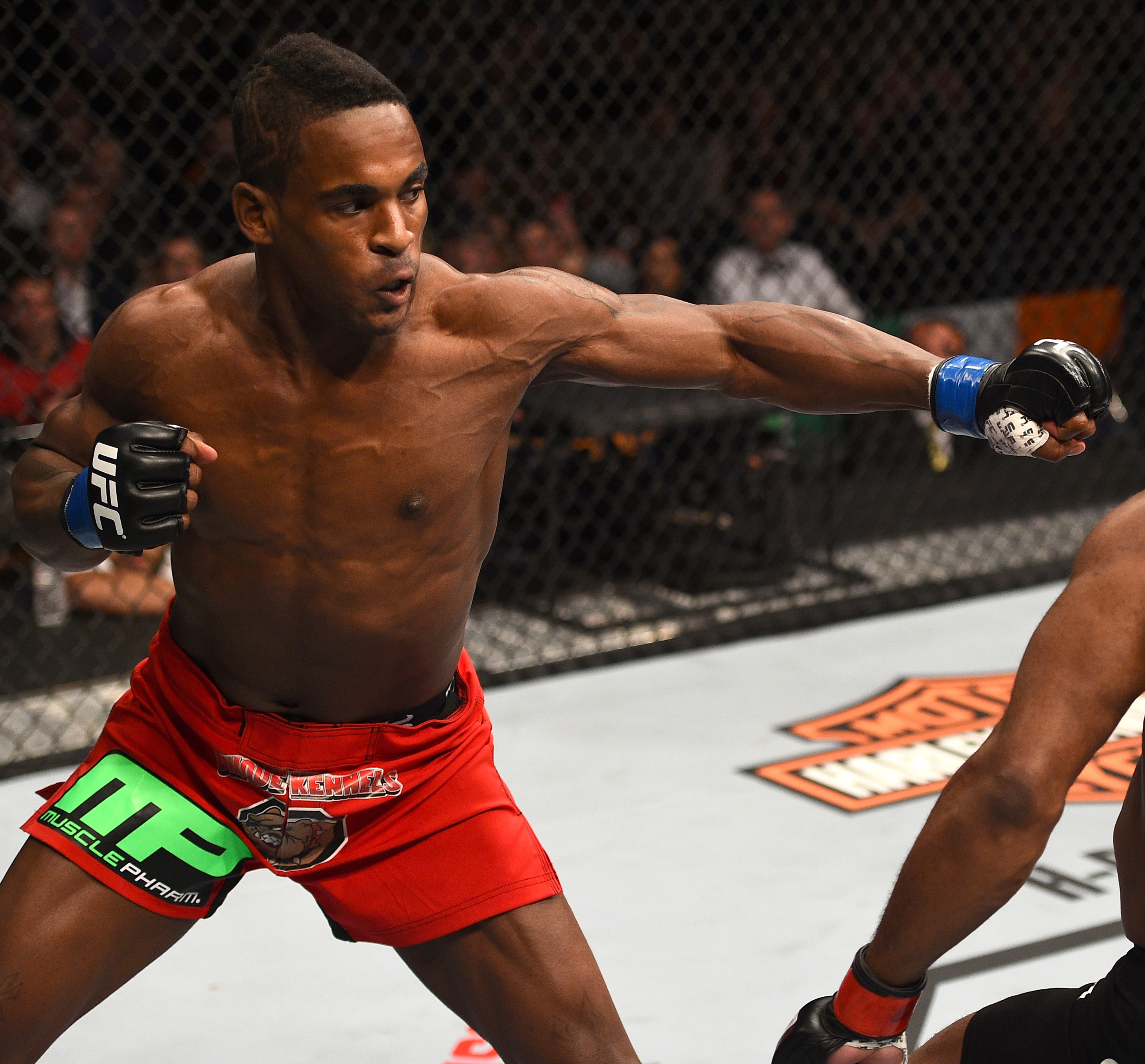 (L-R) Lorenz Larkin punches John Howard in their welterweight fight during the UFC Fight Night event at the TD Garden on January 18, 2015 in Boston, Massachusetts. (Photo by Jeff Bottari/Zuffa LLC)