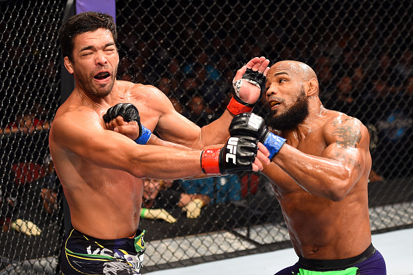 (R-L) Yoel Romero of Cuba punches Lyoto Machida of Brazil in their middleweight during the UFC Fight Night event at the Hard Rock Live on June 27, 2015 in Hollywood, Florida. (Photo by Josh Hedges/Zuffa LLC via Getty Images)