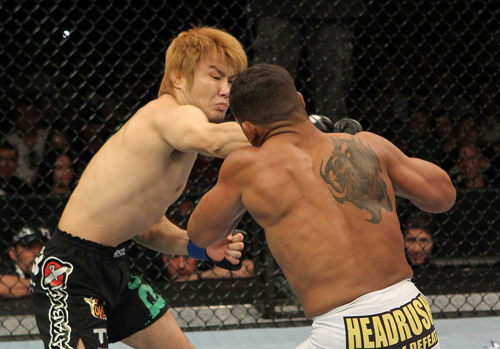 Takanori Gomi punches <a href='../fighter/Tyson-Griffin'>Tyson Griffin</a> during their bout from 2010