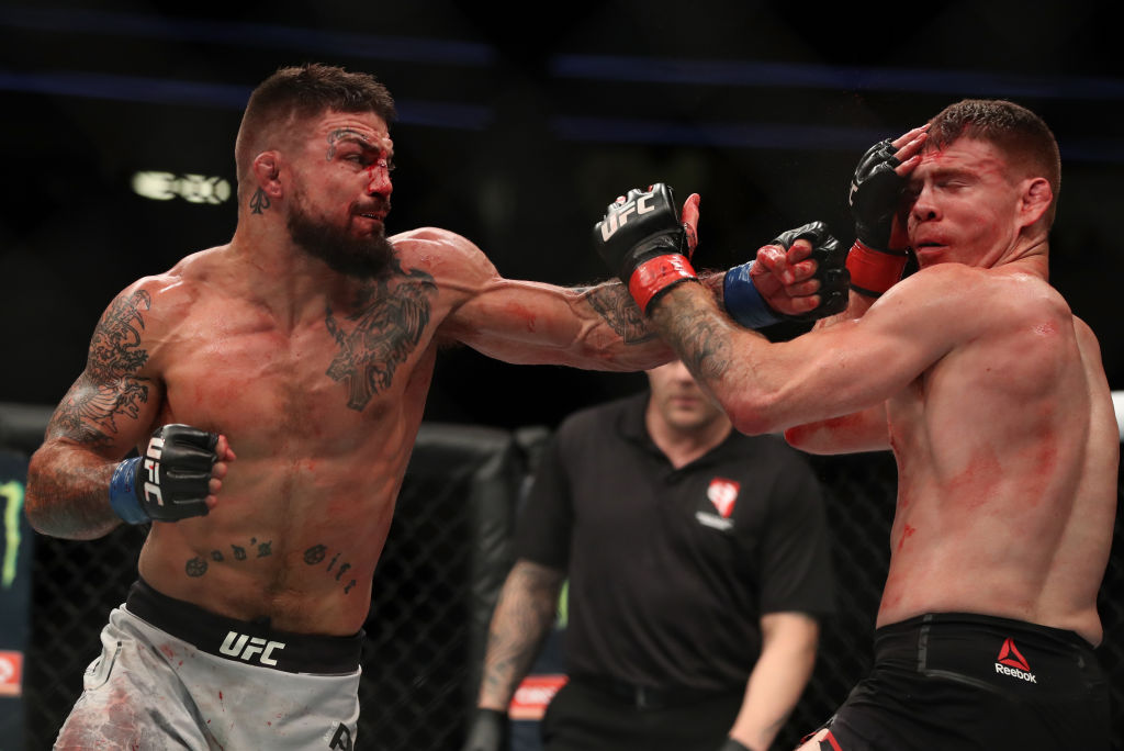 LAS VEGAS, NV - JULY 07: <a href='../fighter/mike-perry'>Mike Perry</a> punches <a href='../fighter/paul-felder'>Paul Felder</a> in their welterweight fight during the UFC 226 event inside T-Mobile Arena on July 7, 2018 in Las Vegas, Nevada. (Photo by Christian Petersen/Zuffa LLC/Zuffa LLC via Getty Images)