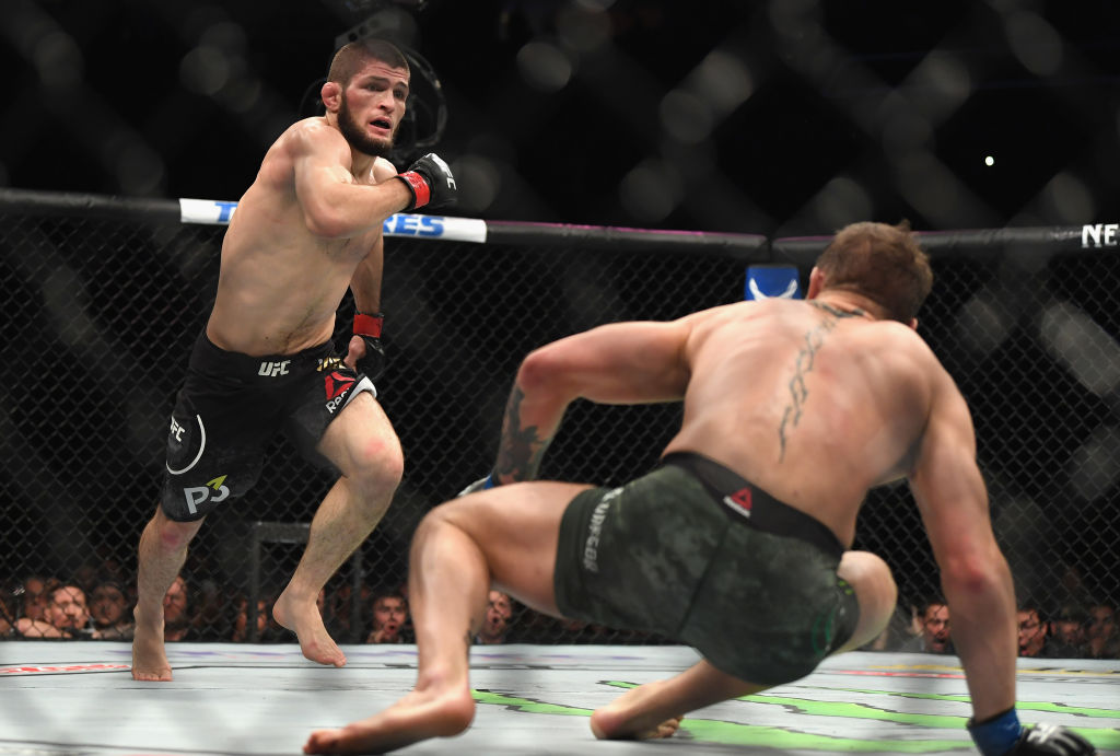 LAS VEGAS, NV - OCTOBER 06: <a href='../fighter/Khabib-Nurmagomedov'>Khabib Nurmagomedov</a> of Russia (L) chases down <a href='../fighter/Conor-McGregor'>Conor McGregor</a> of Ireland in their UFC lightweight championship bout during the UFC 229 event inside T-Mobile Arena on October 6, 2018 in Las Vegas, Nevada. (Photo by Harry How/Getty Images)
