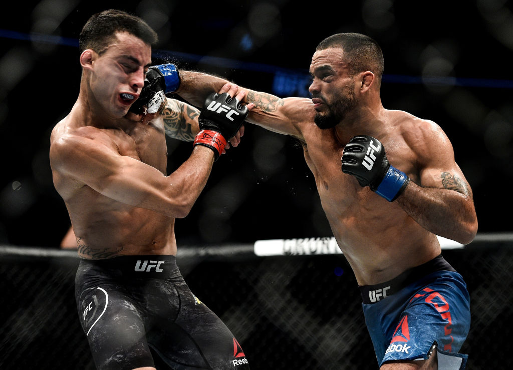 Rob Font punches Thomas Almeida during UFC 220 in Boston, MA. (Photo by Brandon Magnus/Zuffa LLC)