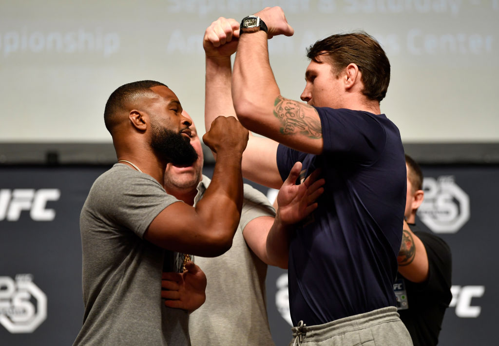 LOS ANGELES, CA - AUGUST 03:  (L-R) Opponents Tyron Woodley and Darren Till face off during the UFC press conference inside the Orpheum Theater on August 3, 2018 in Los Angeles, California. (Photo by Jeff Bottari/Zuffa LLC/Zuffa LLC via Getty Images)