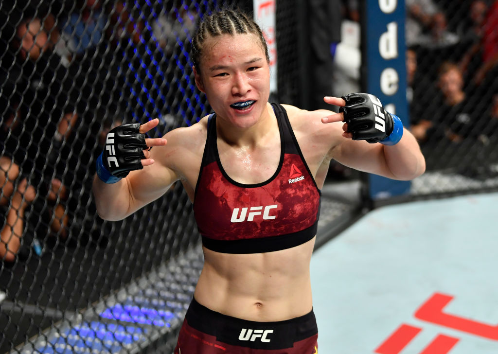 LOS ANGELES, CA - AUGUST 04:  Weili Zhang of China reacts after the conclusion of her women's strawweight fight  against Danielle Taylor during the UFC 227 event inside Staples Center on August 4, 2018 in Los Angeles, California. (Photo by Jeff Bottari/Zuffa LLC/Zuffa LLC via Getty Images)