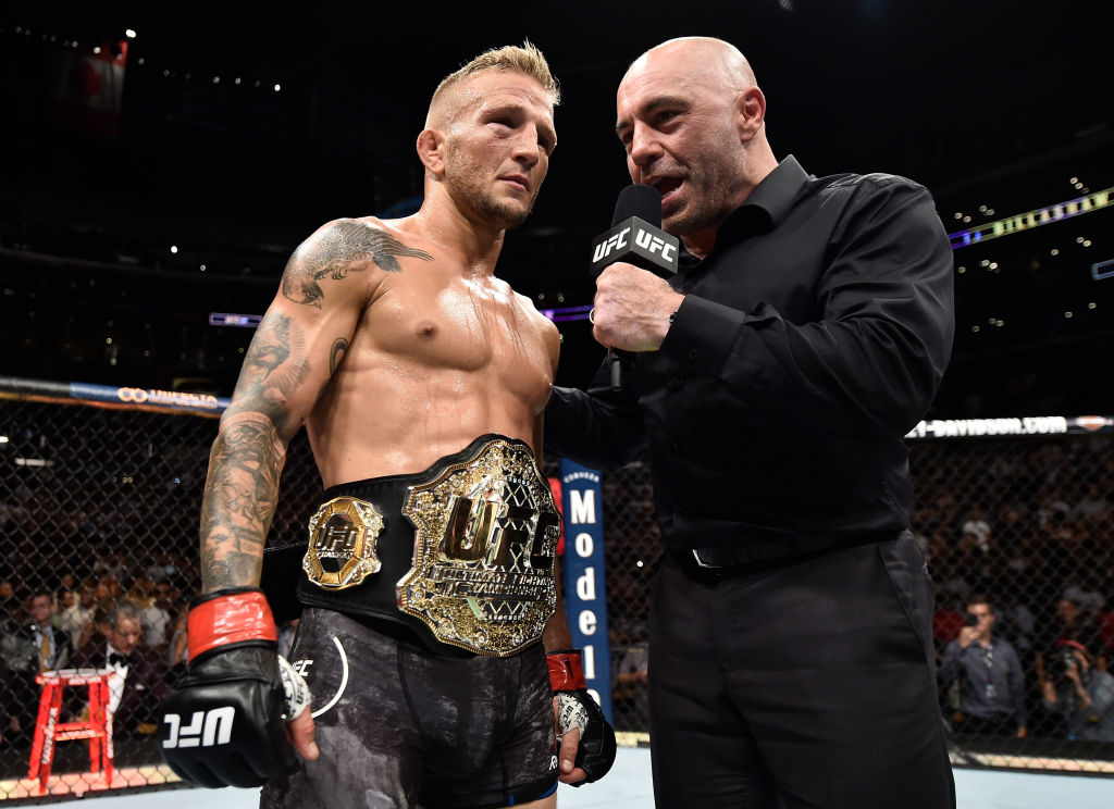 LOS ANGELES, CA - AUGUST 04:  TJ Dillashaw is interviewed by Joe Rogan after his knockout victory over Cody Garbrandt in their UFC bantamweight championship fight during the UFC 227 event inside Staples Center on August 4, 2018 in Los Angeles, California. (Photo by Jeff Bottari/Zuffa LLC/Zuffa LLC via Getty Images)
