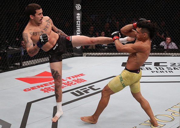 BELEM, BRAZIL - FEBRUARY 03: (L-R) <a href='../fighter/marlon-vera'>Marlon Vera</a> of Ecuador kicks <a href='../fighter/Douglas-Silva-de-Andrade'>Douglas Silva de Andrade</a> of Brazil in their bantamweight bout during the <a href='../event/UFC-Silva-vs-Irvin'>UFC Fight Night </a>event at Mangueirinho Arena on February 03, 2018 in Belem, Brazil. (Photo by Buda Mendes/Zuffa LLC/Zuffa LLC via Getty Images)