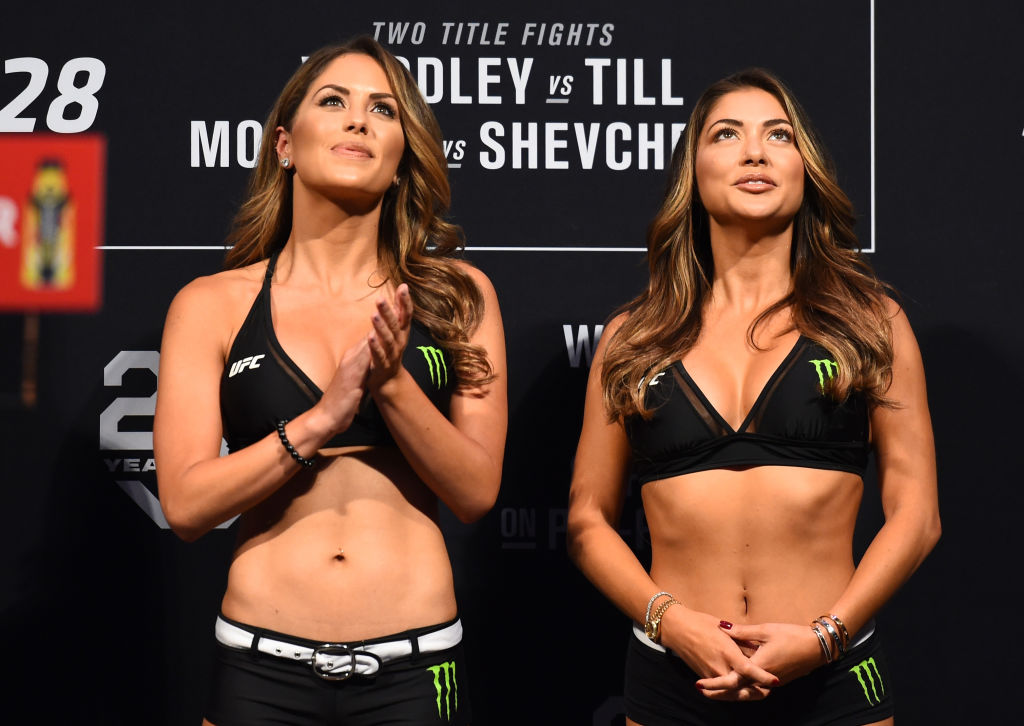 DALLAS, TX - SEPTEMBER 07:   (L-R) UFC Octagon Girls Brittney Palmer and Arianny Celeste stand on stage during the UFC 228 weigh-in at American Airlines Center on September 7, 2018 in Dallas, Texas. (Photo by Josh Hedges/Zuffa LLC/Zuffa LLC via Getty Images)