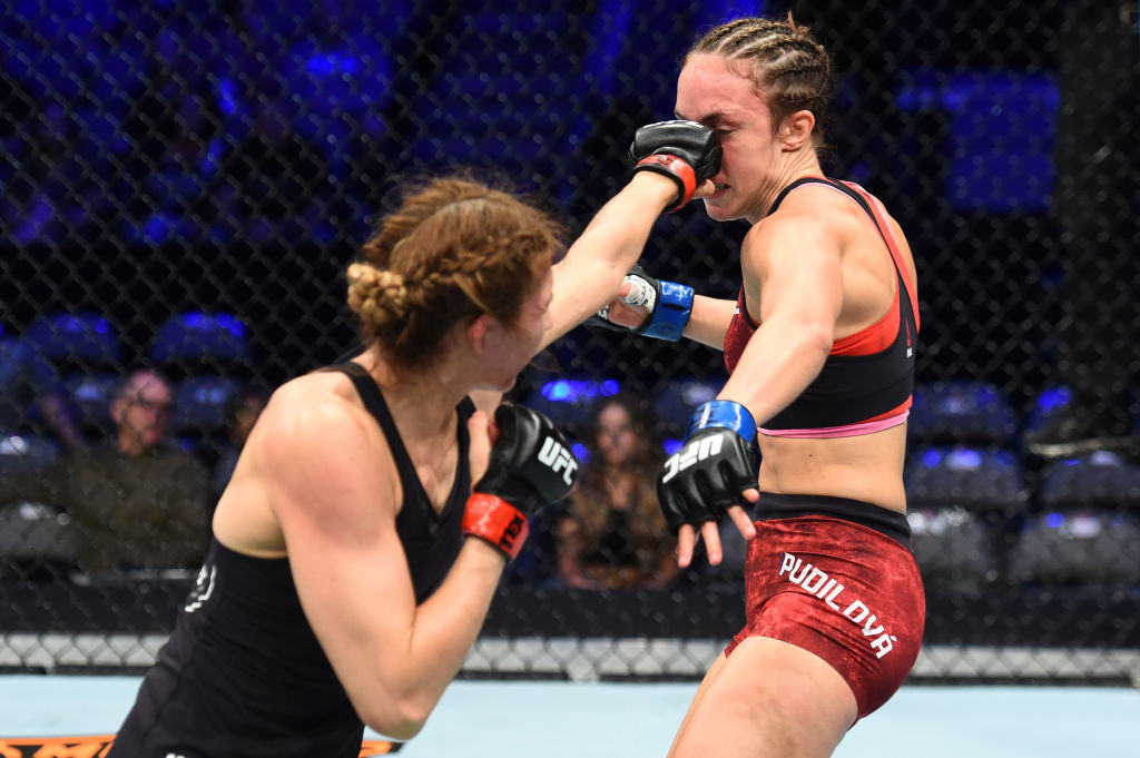 DALLAS, TX - SEPTEMBER 08:  (L-R) Irene Aldana of Mexico punches Lucie Pudilova of Czech Republic in their women's bantamweight fight during the UFC 228 event at American Airlines Center on September 8, 2018 in Dallas, Texas. (Photo by Josh Hedges/Zuffa LLC/Zuffa LLC via Getty Images)