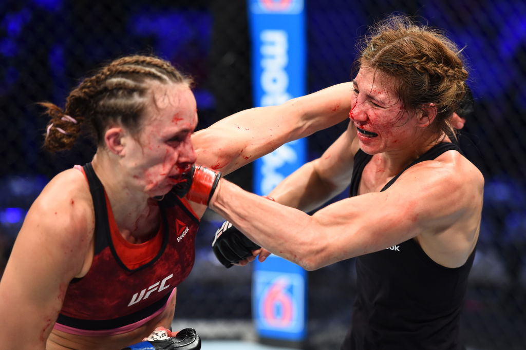 DALLAS, TX - SEPTEMBER 08:  (R-L) Irene Aldana of Mexico punches Lucie Pudilova of Czech Republic in their women's bantamweight fight during the UFC 228 event at American Airlines Center on September 8, 2018 in Dallas, Texas. (Photo by Josh Hedges/Zuffa LLC/Zuffa LLC via Getty Images)