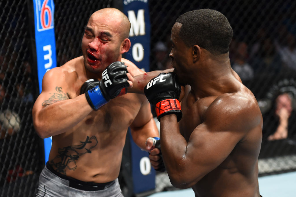 DALLAS, TX - SEPTEMBER 08:  (R-L) Geoff Neal punches Frank Camacho of Guam in their welterweight fight during the UFC 228 event at American Airlines Center on September 8, 2018 in Dallas, Texas. (Photo by Josh Hedges/Zuffa LLC/Zuffa LLC via Getty Images)