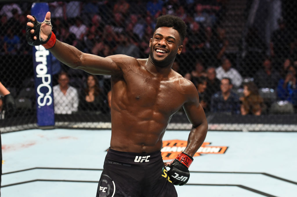 DALLAS, TX - SEPTEMBER 08:  Aljamain Sterling celebrates his submission victory over Cody Stamann in their bantamweight fight during the UFC 228 event at American Airlines Center on September 8, 2018 in Dallas, Texas. (Photo by Josh Hedges/Zuffa LLC/Zuffa LLC via Getty Images)