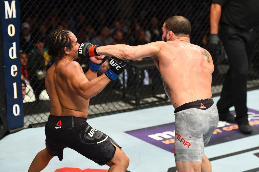 DALLAS, TX - SEPTEMBER 08:  (R-L) Jimmie Rivera punches John Dodson in their bantamweight fight during the UFC 228 event at American Airlines Center on September 8, 2018 in Dallas, Texas. (Photo by Josh Hedges/Zuffa LLC/Zuffa LLC via Getty Images)