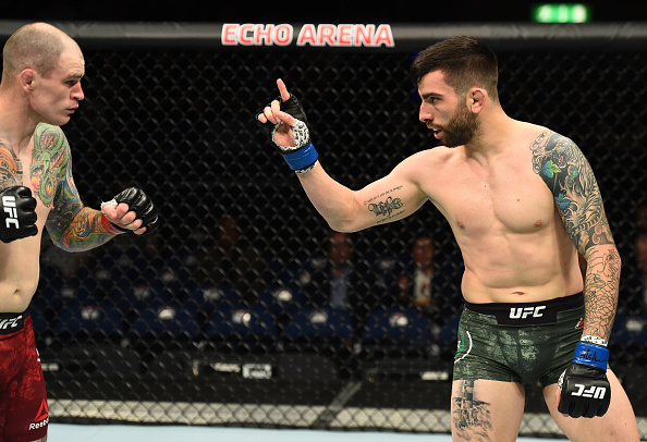 LIVERPOOL, ENGLAND - MAY 27: (R-L) Carlo Pedersoli taunts Bradley Scott of England in their welterweight bout during the UFC Fight Night event at ECHO Arena on May 27, 2018 in Liverpool, England. (Photo by Josh Hedges/Zuffa LLC/Zuffa LLC via Getty Images)