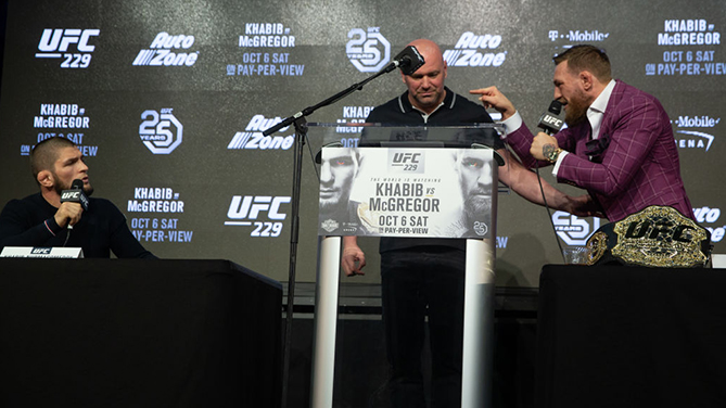 NEW YORK, NY - SEPTEMBER 20: UFC lightweight champion Khabib Nurmagomedov (L) and Conor McGregor (R) exchange words around UFC president Dana White (C) during the UFC 229 press conference at Radio City Music Hall on September 20, 2018 in New York City. Nurmagomedov and McGregor will meet in the main event on October 6, 2018 at the T-Mobile Arena in Las Vegas, Nevada. (Photo by Ed Mulholland/Zuffa LLC/Zuffa LLC via Getty Images)