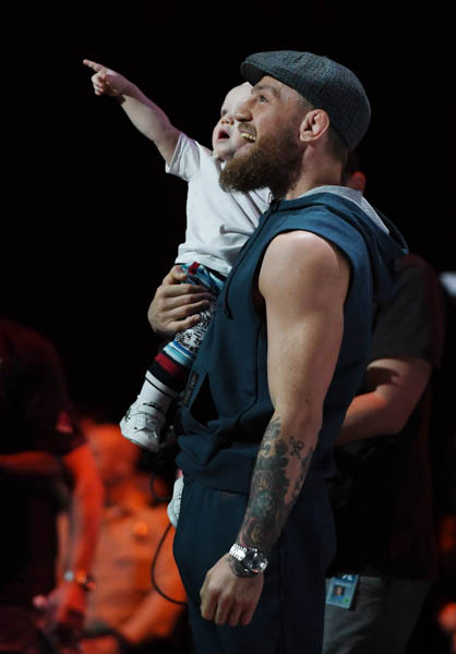 LAS VEGAS, NV - OCTOBER 03:  Conor McGregor holds his son Conor McGregor Jr. during an open workout for UFC 229 at Park Theater at Park MGM on October 03, 2018 in Las Vegas, Nevada. (Photo by Ethan Miller/Getty Images)