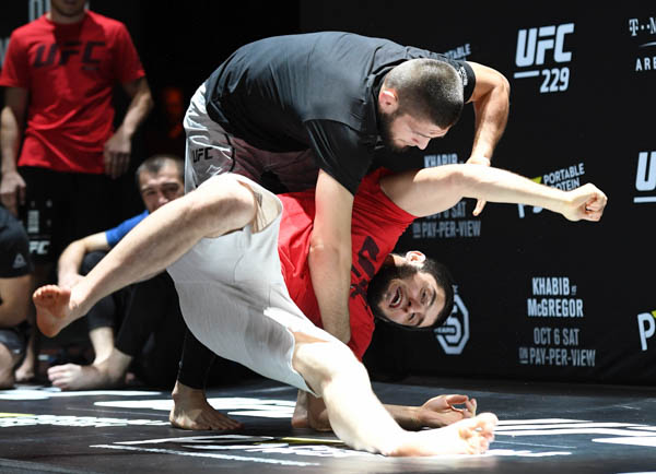 LAS VEGAS, NV - OCTOBER 03:  UFC lightweight champion Khabib Nurmagomedov (top) throws a sparring partner during an open workout for UFC 229 at Park Theater at Park MGM on October 03, 2018 in Las Vegas, Nevada. (Photo by Ethan Miller/Getty Images)