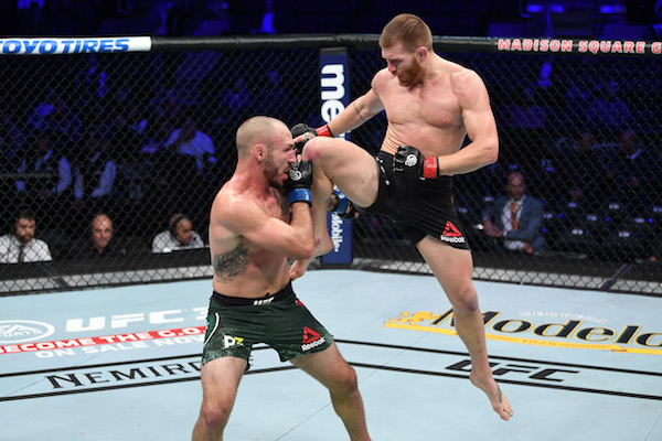 NEW YORK, NY - NOVEMBER 03:  (R-L) <a href='../fighter/Matt-Frevola'>Matt Frevola</a> attempts a flying knee against <a href='../fighter/Landon-Vannata'>Lando Vannata</a> in their lightweight bout during the UFC 230 event inside Madison Square Garden on November 3, 2018 in New York, New York. (Photo by Jeff Bottari/Zuffa LLC via Getty Images)