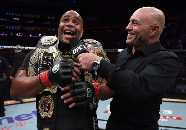 NEW YORK, NY - NOVEMBER 03:  <a href='../fighter/Daniel-Cormier'>Daniel Cormier</a> is interviewed by Joe Rogan after his submission victory over <a href='../fighter/Derrick-Lewis'>Derrick Lewis</a> in their UFC heavyweight championship bout during the UFC 230 event inside Madison Square Garden on November 3, 2018 in New York, New York. (Photo by Jeff Bottari/Zuffa LLC via Getty Images)