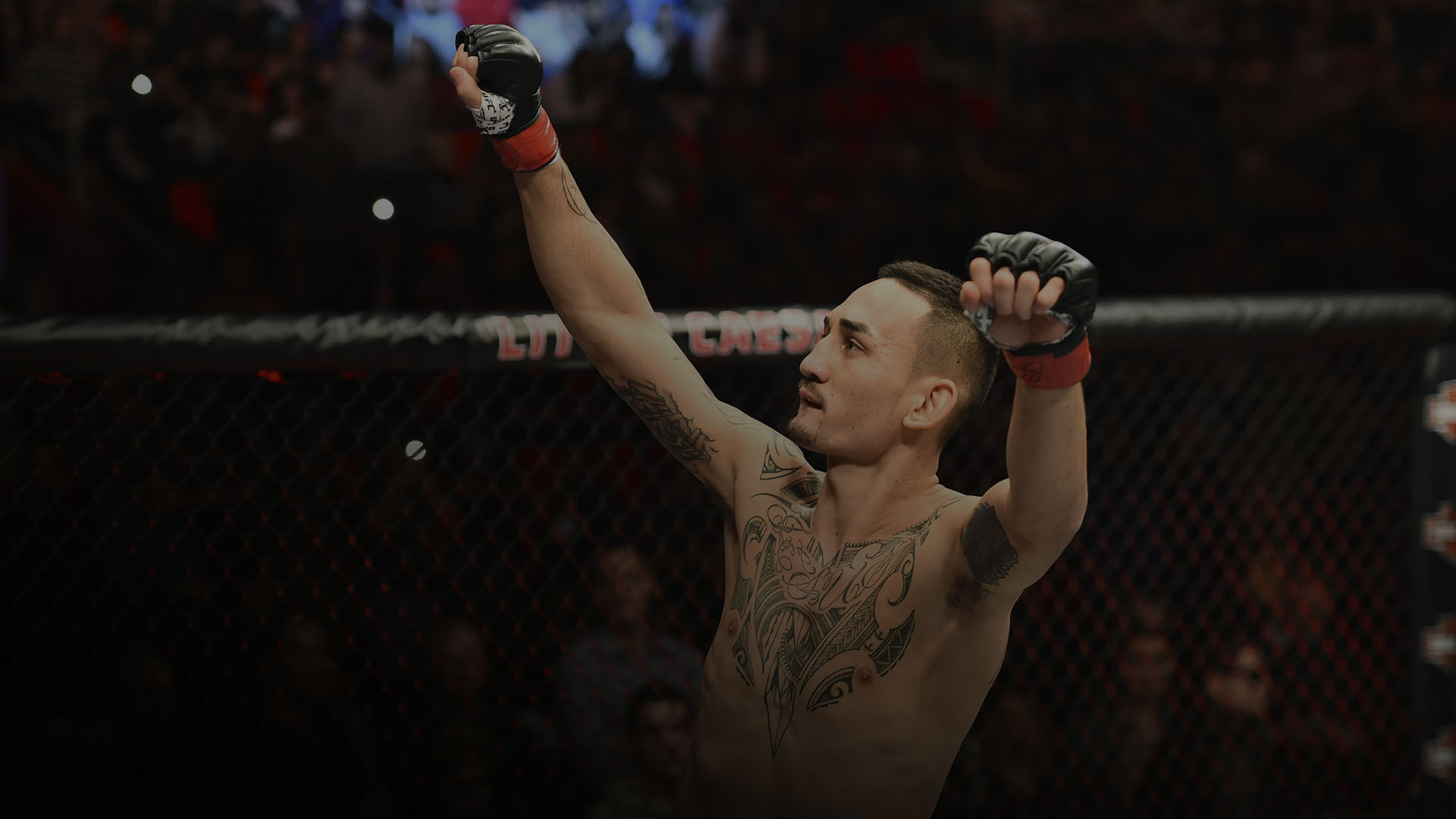 DETROIT, MI - DECEMBER 02: Max Holloway signals to the crowd as he enters the Octagon prior to facing Jose Aldo of Brazil in their UFC featherweight championship bout during the UFC 218 event inside Little Caesars Arena on December 02, 2017 in Detroit, Michigan. (Photo by Josh Hedges/Zuffa LLC/Zuffa LLC via Getty Images)
