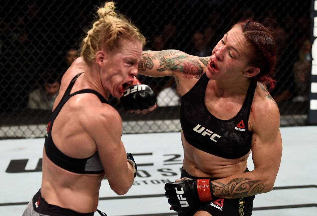 LAS VEGAS, NV - DECEMBER 30: (R-L) <a href='../fighter/cris-cyborg'>Cris Cyborg</a> of Brazil punches <a href='../fighter/holly-holm'>Holly Holm</a> in their women's featherweight bout during the UFC 219 event inside T-Mobile Arena on December 30, 2017 in Las Vegas, Nevada. (Photo by Jeff Bottari/Zuffa LLC/Zuffa LLC via Getty Images)