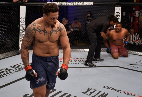 LAS VEGAS, NV - AUGUST 07: <a href='../fighter/Greg-Hardy'>Greg Hardy</a> celebrates after his TKO victory over <a href='../fighter/Tebaris-Gordon'>Tebaris Gordon</a> in their heavyweight fight during Dana White's Tuesday Night Contender Series at the TUF Gym on August 7, 2018 in Las Vegas, Nevada. (Photo by Chris Unger/DWTNCS LLC)