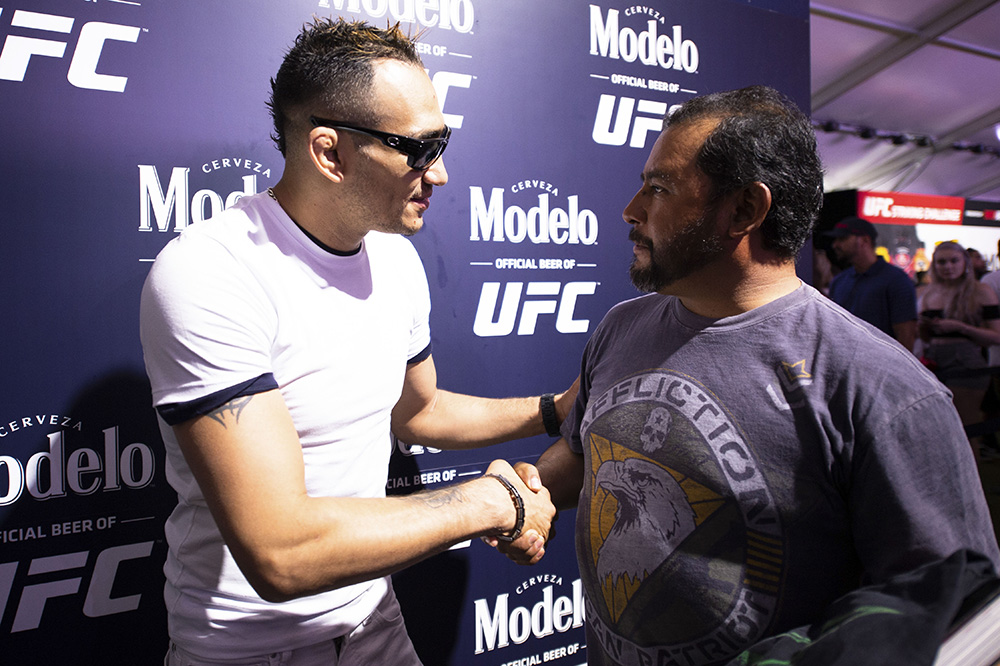 Tony Ferguson greets a UFC fan during the UFC's International Fight Week.