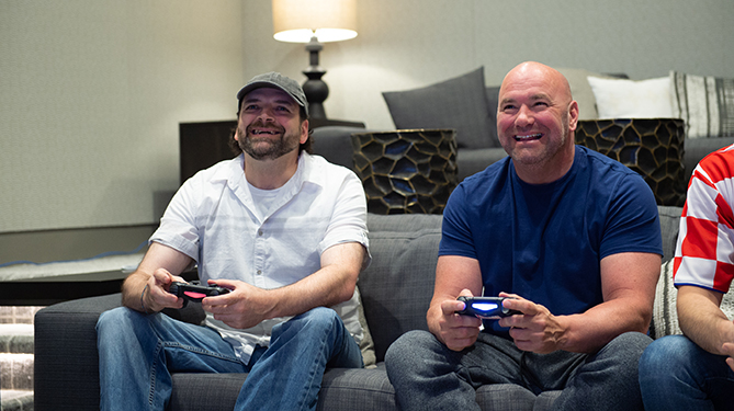 EA SPORTS UFC 3 #BeTheBoss winner John Farmer plays UFC 3 with UFC President Dana White at the UFC headquarters in Las Vegas, NV.
