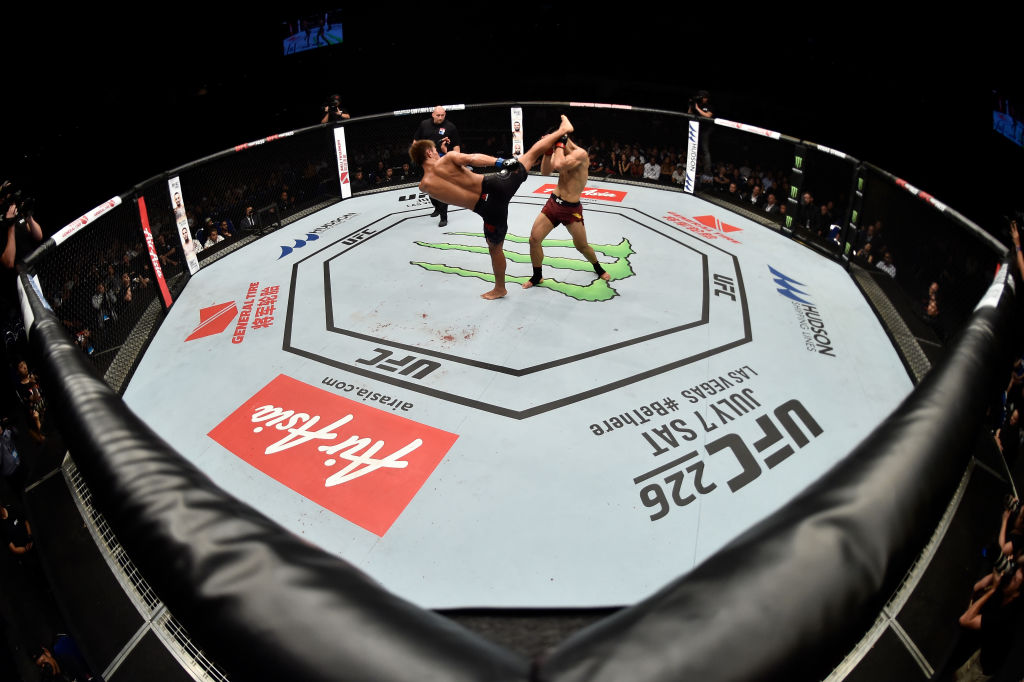 SINGAPORE - JUNE 23:  (L-R) Daichi Abe of Japan kicks Li Jingliang of China in their welterweight bout during the UFC Fight Night event at the Singapore Indoor Stadium on June 23, 2018 in Singapore. (Photo by Jeff Bottari/Zuffa LLC)