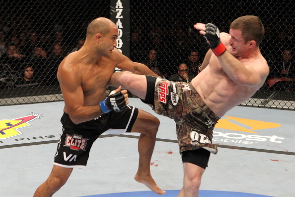 BJ Penn fights against Matt Hughes during their bout at UFC 123 on 11/20/10, in Auburn Hills, MI (Photo by Josh Hedges/Zuffa LLC)