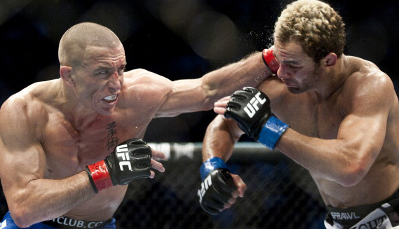 Georges St-Pierre (L) from Montreal, Canada punches Josh Koscheck from Waynesburg US during the third round of the Ultimate Fighting Championship on December 11, 2010 at Bell Centre in Montreal, Quebec, Canada. (Photo: ROGERIO BARBOSA/AFP)