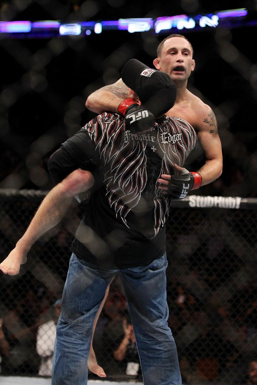 UFC 118 Edgar celebrating