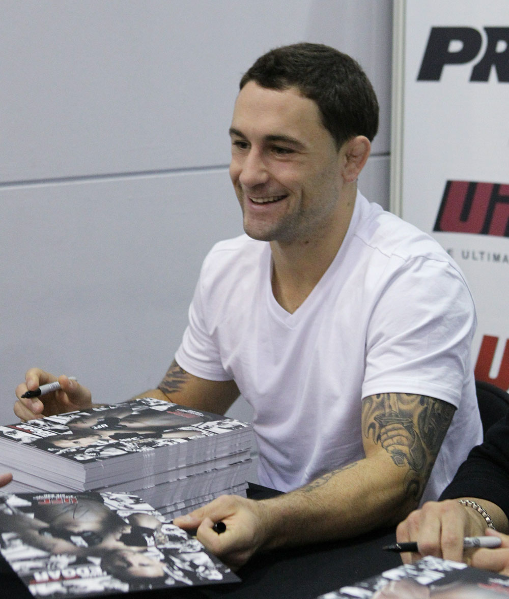 UFC Lightweight Champion Frankie Edgar signs an autograph for a fan at the UFC Fan Expo London