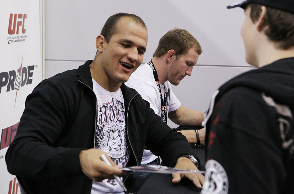 UFC Heavyweight contender Junior dos Santos signs an autograph for a fan at the UFC Fan Expo.