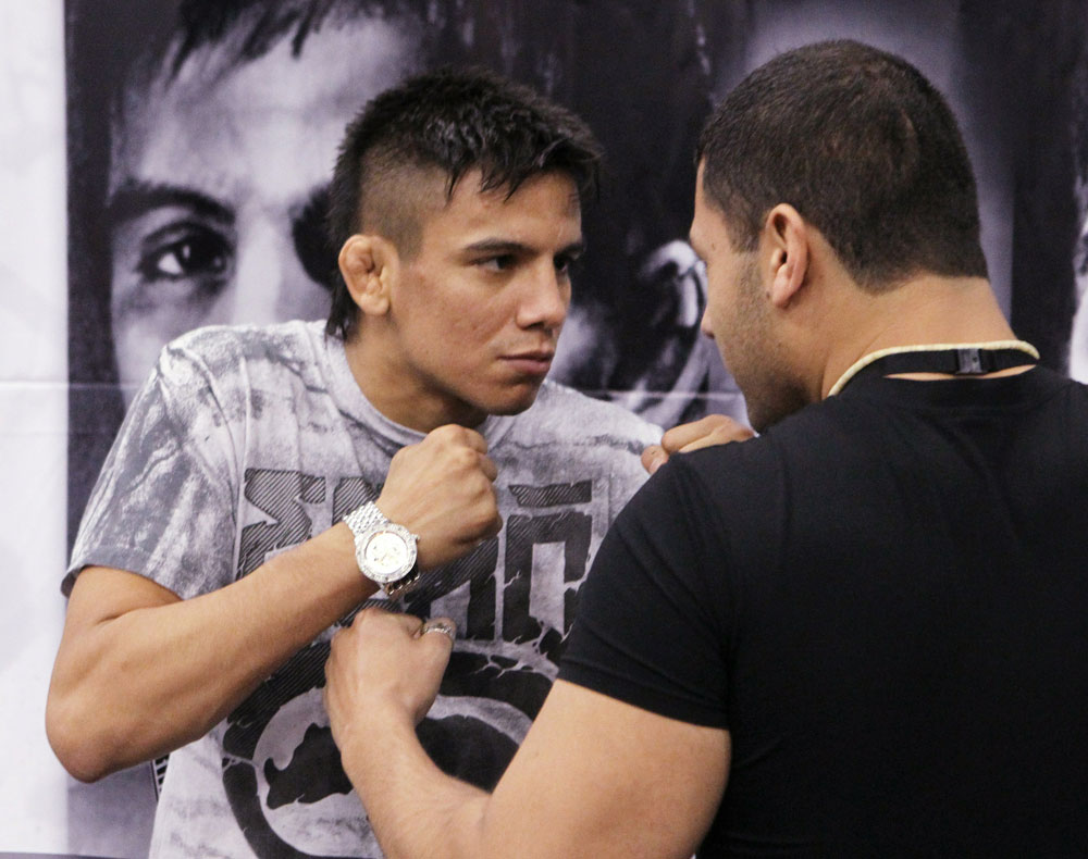 WEC Bantamweight fighter Miguel Angel Torres (L) faces off with a fan at the UFC Fan Expo London.