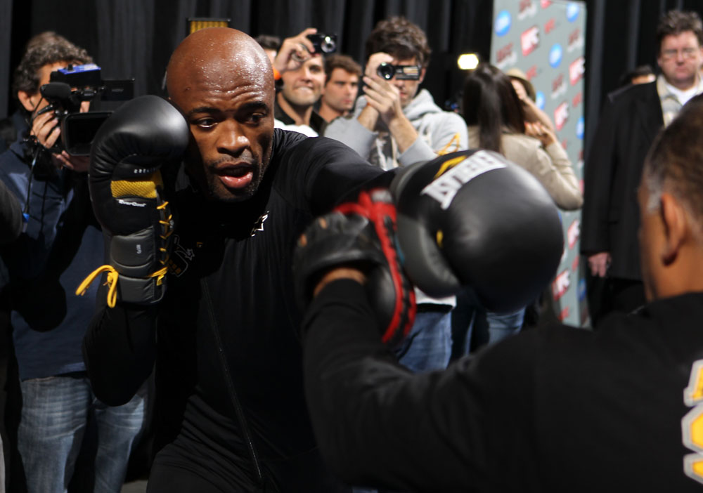Silva hits pads at open workout