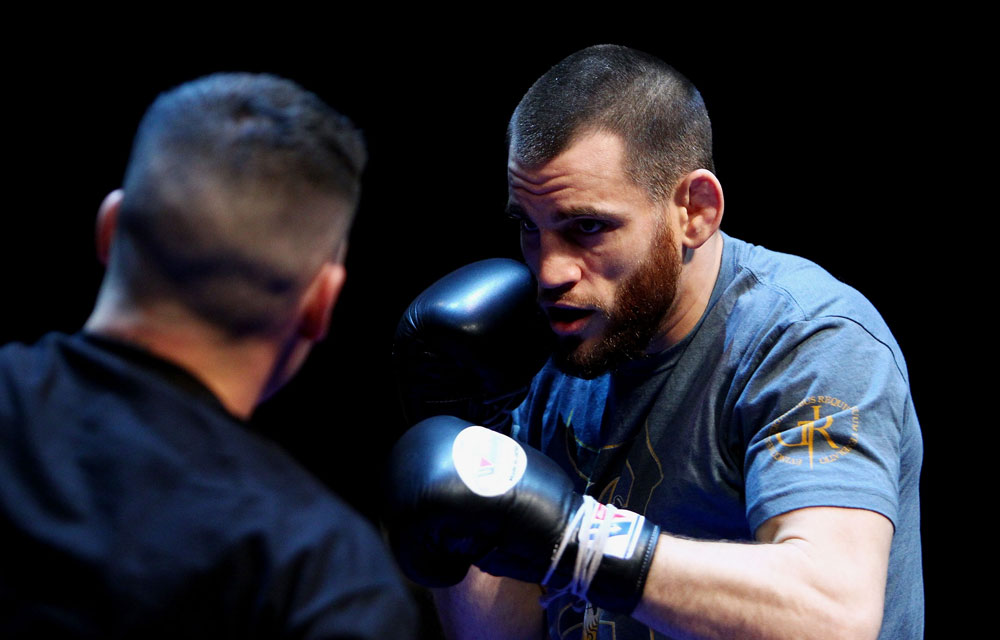 Jon Fitch does some glove work during an Open Workout