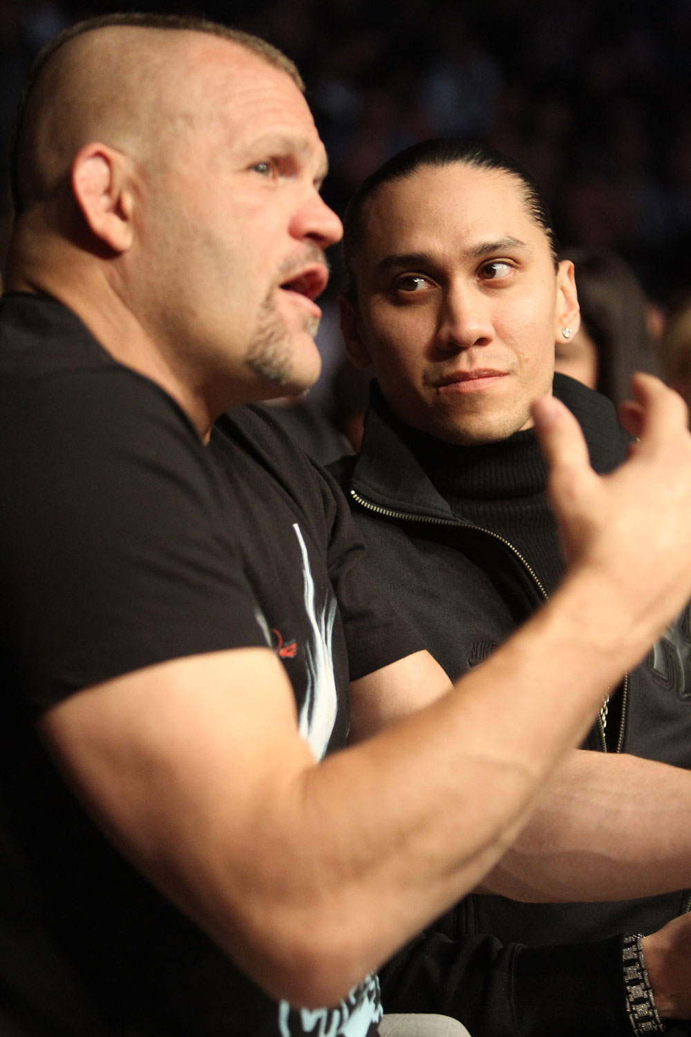 (L-R) UFC Hall of Famer Chuck Liddell and musician Taboo take in the fights at UFC 128 at the Prudential Center on March 19, 2011 in Newark, New Jersey.