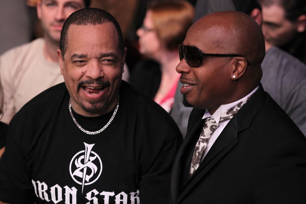UFC 128: (L-R) Actor Ice-T and rapper M.C. Hammer take in the fights