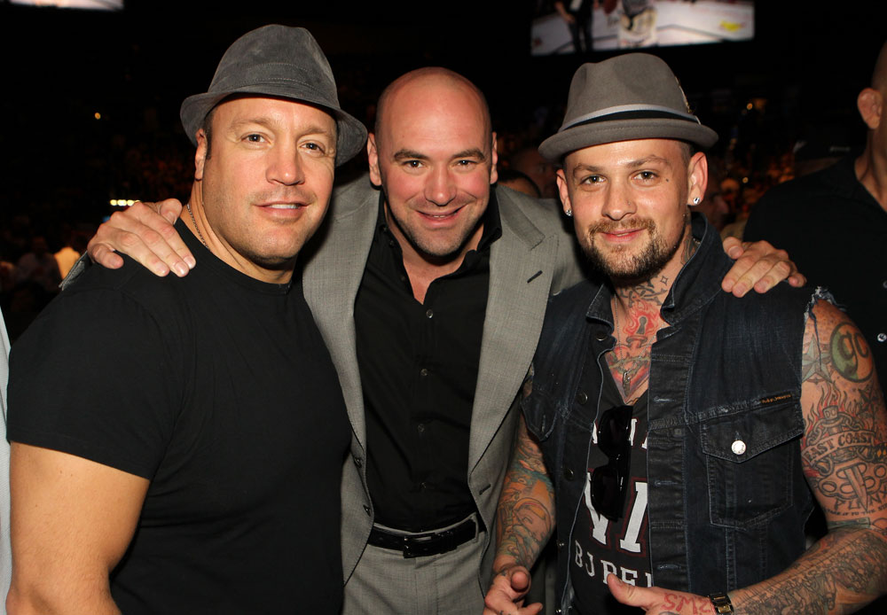 UFC President Dana White (center) poses for a photo with actor Kevin James (L) and musician Benji Madden (R) Octagonside.