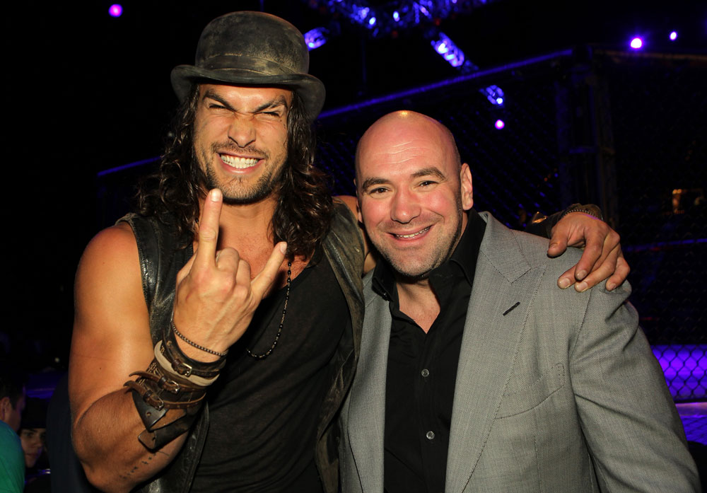 (L-R) Actor Jason Momoa and UFC President Dana White pose for a photo Octagonside at UFC 132.