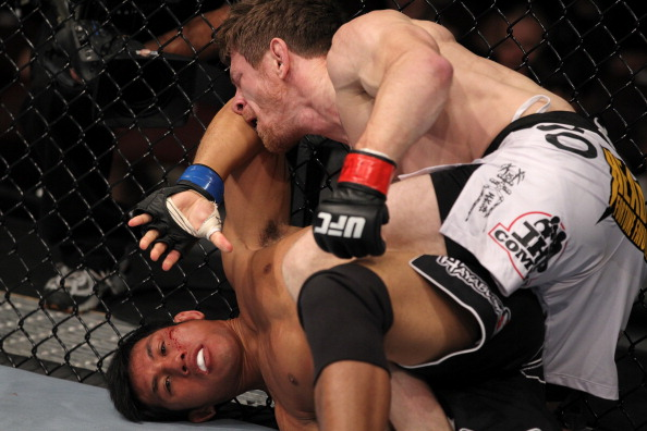 Mike Brown throws punches at Nam Phan at UFC 133