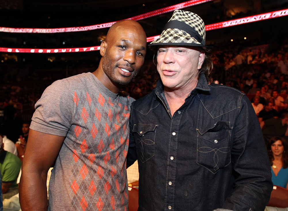 UFC 133: (L-R) Boxing champion Bernard Hopkins and actor Mickey Rourke pose for a photo octagonside at UFC 133.