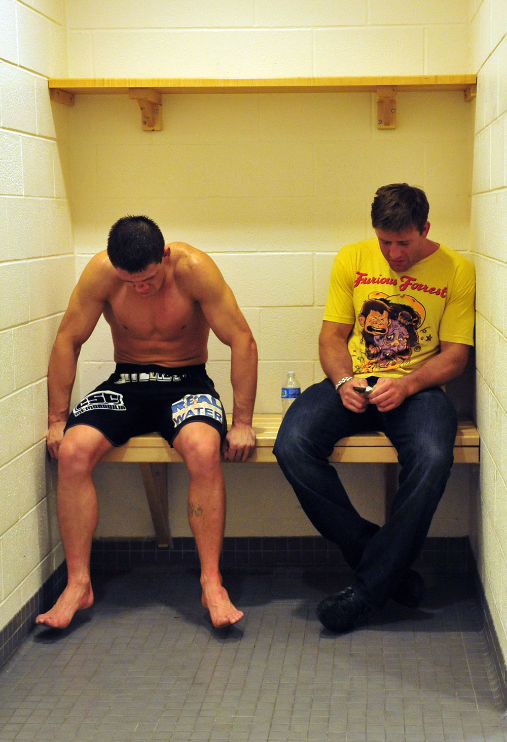 A disappointed Steve Cantwell sis in a corner in his dressing room with teammate Stephan Bonnar after his loss to Mike Massenzio
